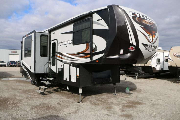 "SPACIOUS AND TOUGH!!!  2017 Heartland Cyclone 3513 ATVs, snowmobiles, and dirt bikes OH MY! This toy hauler has the grit to pull whatever toy you're headed out with! a 13' garage offers plenty of space to stash all your cargo. With a GVWR of 17,000 lbs and a dry weight of 14,164 lbs, this 39' 1"" long RV is left with 2,836 lbs of cargo ability! Give our Cyclone expert John Sobczak a call 231-903-6220 for pricing and more information."
