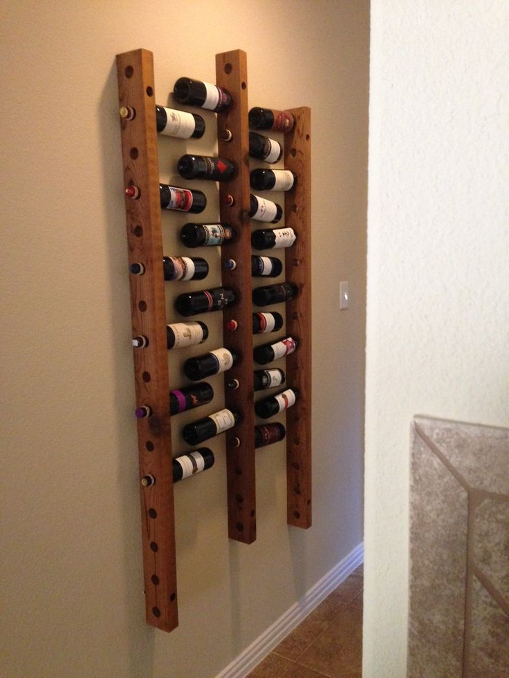 I made this wine rack that hangs on the wall, will hold up to 48 bottles of wine.