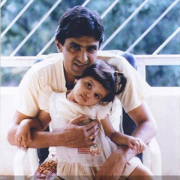 The lovely Deepika with her father Prakash Padukone. This dimpled tiny tot looks so adorable.