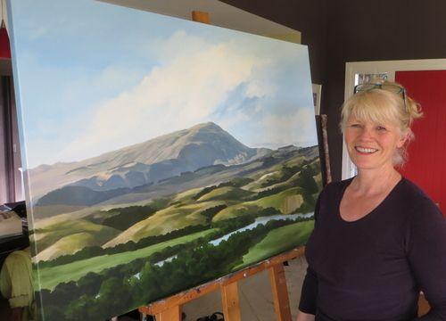New Zealand artist Jane Sinclair in her studio. See her landscapes on www.ArtsyShark.com