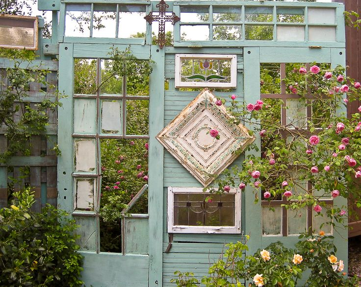"""old doors in the garden can create """"rooms"""" & openings for blooms to grow through"""