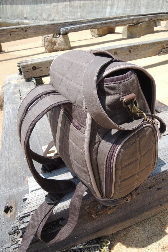 The BEST diaper bag I've ever used.  Stroller straps, backpack straps, over the shoulder strap, insulated bottle compartments, flat surfaced bottom, full zip front, and comes with a diaper changing pad.  Reasonably priced and worth every penny!