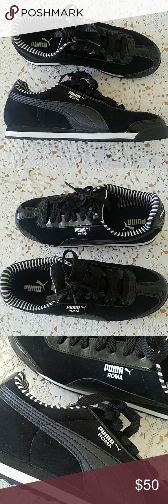 Puma Roma Sneakers Black suede puma roma sneakers with black and white strips inside. Worn once in brand new condition! I'm a true size 8 and they fit me a bit big. Can be both women's and men's. Super cute and comfy! Puma Shoes Sneakers