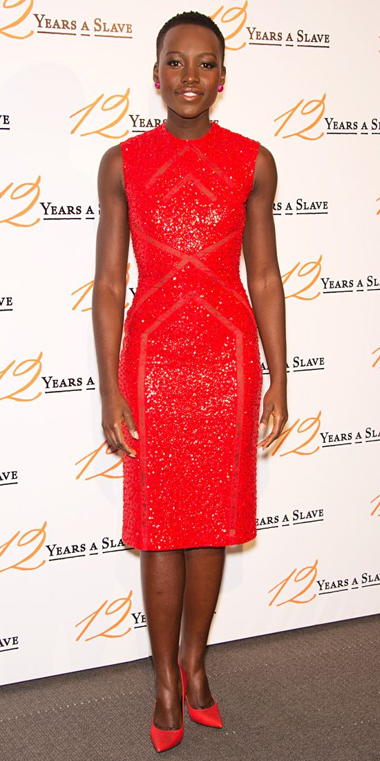LUPITA NYONG'O At the Paris premiere of 12 Years a Slave, Lupita Nyong'o was a vision in monochromatic red, matching her sequined Elie Saab dress with David Yurman studs and pumps.