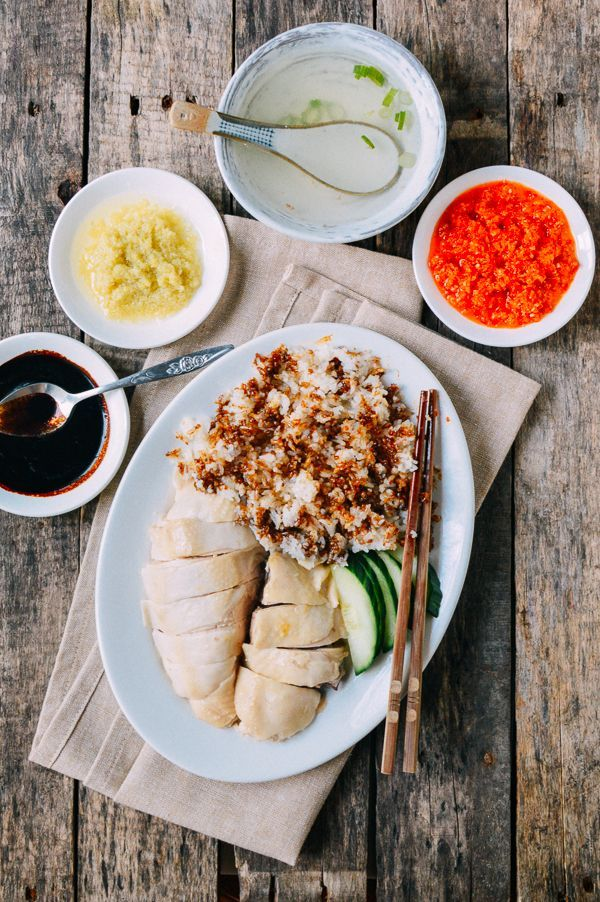 Hainanese Chicken Rice, by thewoksoflife.com | #Chinese (original) . [chicken: cooked with ginger, scallions. then ice bath] [rice: (preferably jasmine) + Sauce 1: Ginger-Garlic Sauce + Sauce 2: Sweet Dark Soy Sauce + Sauce 3: Chili-Lime Sauce with sesame oil, garlic, ginger]