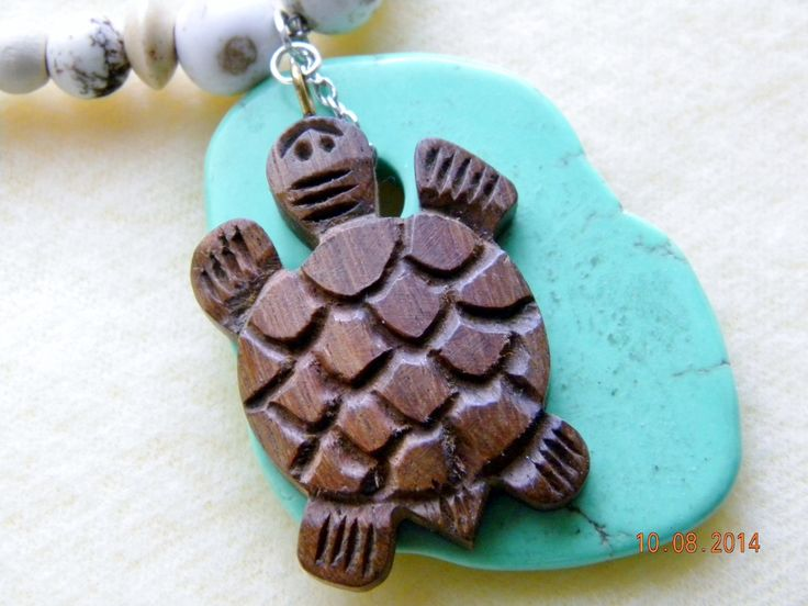 Pale tan turquoise beads and wooden beads sport  a large green turquoise stone with wooden turtle on top. by SantaFeCollection on Etsy