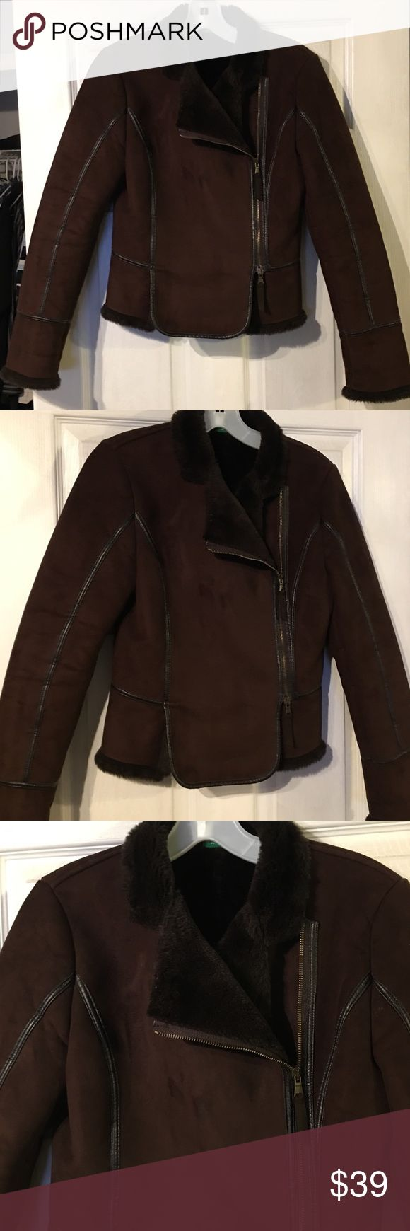 Made in Ukraine of Benetton US 9/10 suede jacket Made in Ukraine of Benetton size US 9/10 suede jacket.  Very good condition and very stylish and warm.  Faux fur lining inside and chocolate brown suede outside zip up jacket United Colors Of Benetton Jackets & Coats Utility Jackets