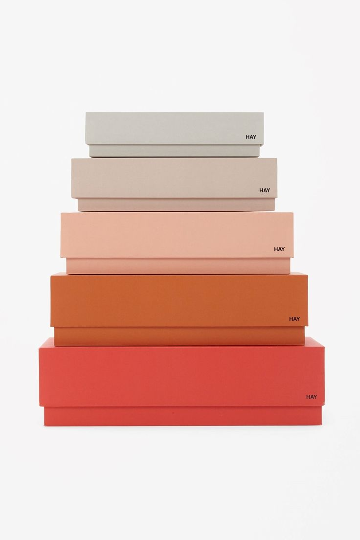 This set of five boxes is made from cardboard in assorted sizes and colours, designed to hold small items. Clean and functional, they also fit inside each other for easy storage.