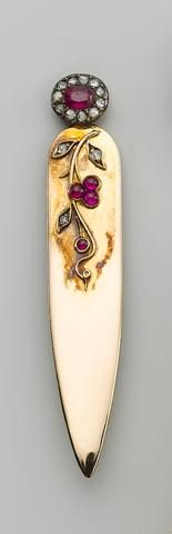 A Faberge gold, diamond and ruby mounted bookmark, workmaster August Hölming, St. Petersburg, late 19th century, the front decorated with cherries.