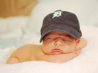 Detroit tigers newborn.  My favorite newborn picture of my girl. Light source to the right. 35mm f1.8 taken at 5 days old with Nikon D40. Detroit Tigers baby!