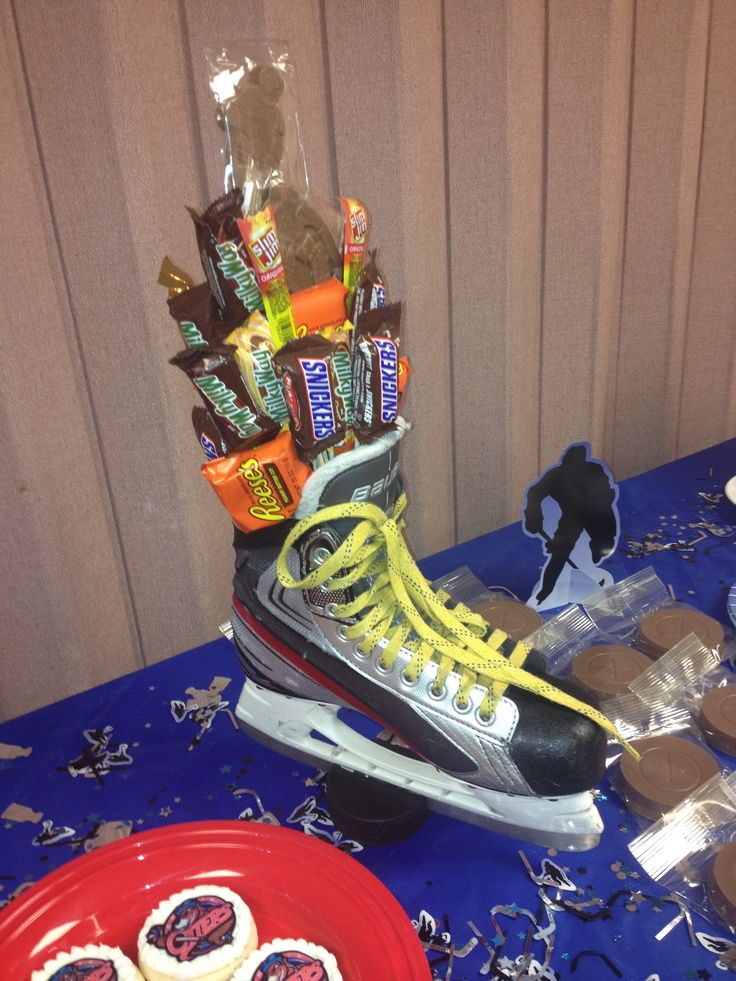 Hockey skate centerpiece-This or something very much like it will most likely be at all the tables of Joanie's wedding reception. Picture flowers instead of candy bars.