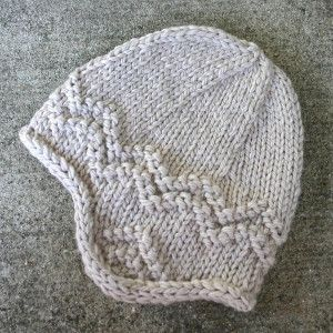 Relive your glory years with the nostalgic North Shore Hat. With this easy knit hat pattern, you won't even have to sacrifice sophistication for the comfort and joy this knit earflap hat is sure to bring. With easy-to-follow instructions and only the use of the basic knitting stitches, the North Shore Hat can easily be taken on by beginner knitters looking to learn how to knit a hat just in time for the cooler nights ahead.