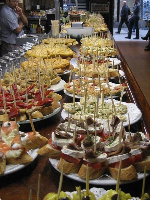 Pintxos are savory Basque finger foods served in pubs. I generally prefer them over the traditional Spanish Tapas.
