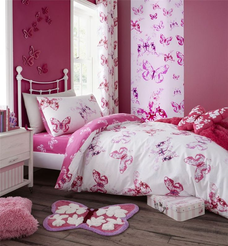 """This duvet comforter cover and fully lined pair of 66"""" x 72"""" (168cm x 183cm) curtains feature a printed watercolour-style themed design. The duvet comforter cover features multiple butterflies in pink on a plain white background to the front, with multiple butterflies in white on a plain pink background to the reverse. 