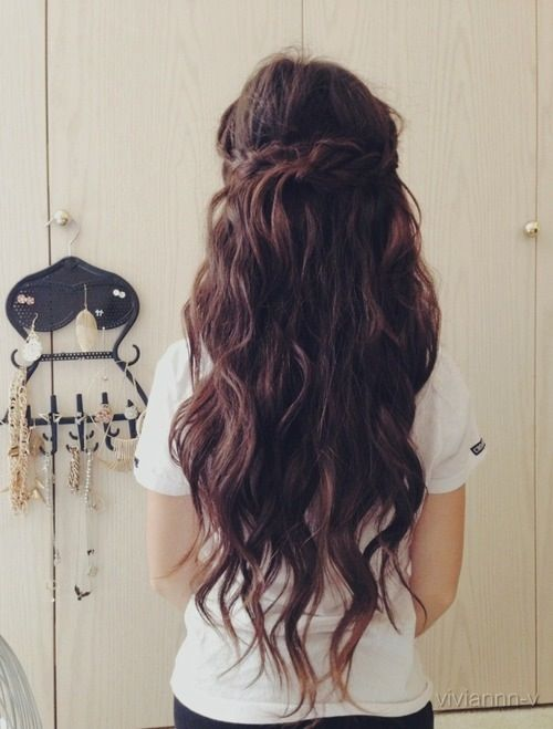 Long brown curly hair with side braid