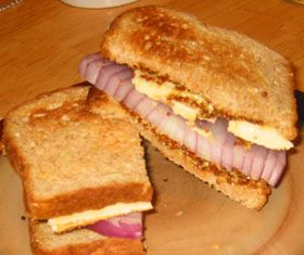 Limburger Cheese Sandwich.  Dark rye bread, brown mustard, thick slice of sweet onion, and a slice of Limburger.  Wash it down with your favorite beer.  I think I might have to try this...