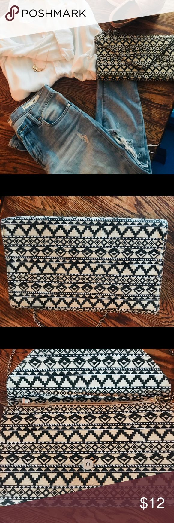 Aztec print hand bag/ over the shoulder bag. Super cute Aztec print bag. Lays flat, silver long strap. Looks great with plain colors to add a little pop! Bags Crossbody Bags