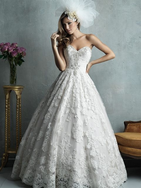 Allure Couture C328 | Oh, the glamor of this ballgown. The classic sweetheart neckline is embellished with a jeweled design, and the full skirt is covered in rich lace embroidered appliques.
