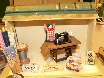 sewing boxroom and happy woman.