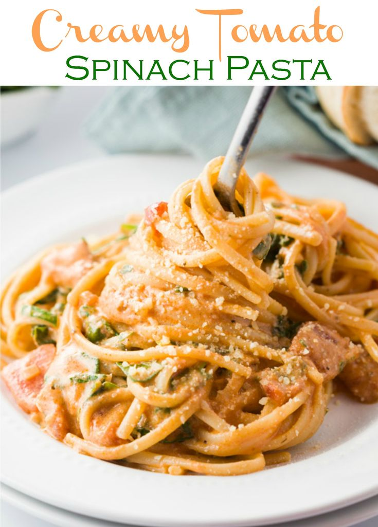 Creamy Tomato Spinach Pasta: This thick and creamy tomato spinach sauce is easy to make and pairs perfectly with linguine or your favorite pasta. An easy weekday meal that the family will love. #Pasta #Italian #Dinner #Linguine #Spaghetti #ItalianFood