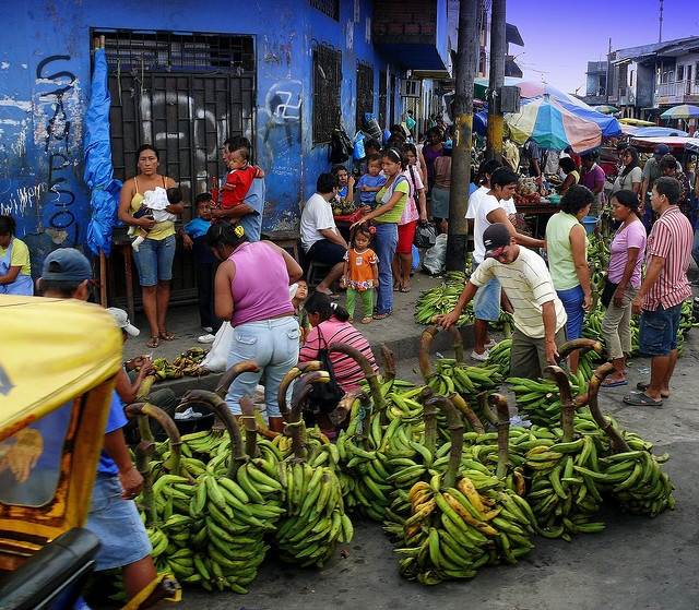 Street Market In Iquitos, Peru contains many fruits which can be bought in big quantities for cheap.