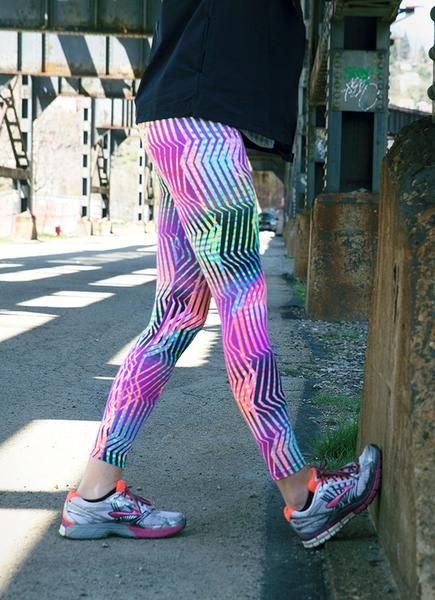 Tight to Try: Go to the Extreme with this print! The black base blends with neons that will take you work out up a notch. The electrifying pattern will send you off in a sprint during your next sweat session! Run, jog or sprint to this amazing collection, including a printed legging, running skirt, workout short and adjustable sports bra! Top off your look with a workout top for a head-to-toe JoJo look!