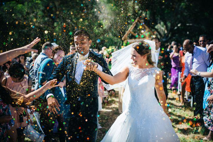 Melissa + Michael wedding glitter exit. Photography by iZO Photography