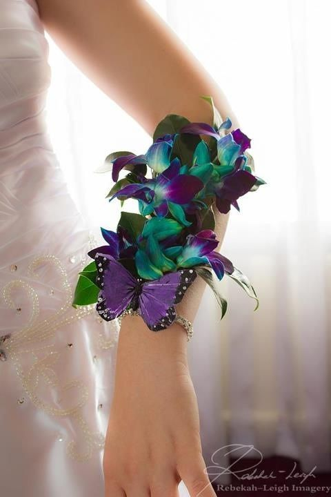 Wrist corsage of blue orchids
