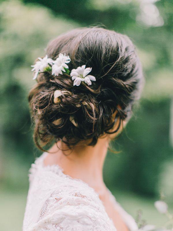 wedding hair with flowers, photo by Rachel May Photography http://ruffledblog.com/clifton-inn-wedding-inspiration #weddinghair #updo #bridal