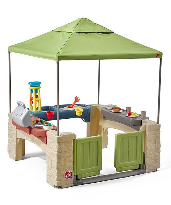 Kids can practice their grilling game with this engaging patio play set that includes a sand and water play are for splashy fun. Includes play set with canopy and accessories set47.5'' W x 60'' H x 47.5'' DPlasticAdult assembly requiredRecommended for ages 2 years and upMade in the USA