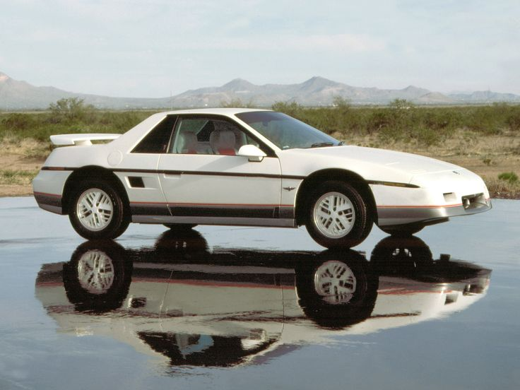 The Pontiac Fiero was a mid-engine sports car built by the Pontiac Motor Division of General Motors from 1984 to 1988.  It had great styling!    pontiac_fiero_84.jpg 2,400×1,800 pixels