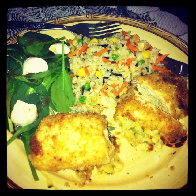 Chicken rollatini stuffed with zucchini and mozzarella, spinach leaves ...