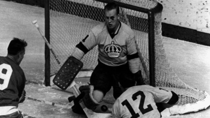 A glorious shot of rookie goalie Wayne Rutledge in his first NHL game. Despite the black eye and puck between the legs, he won 4-0. (Note Gordie Howe sneaking up on the left hand side)