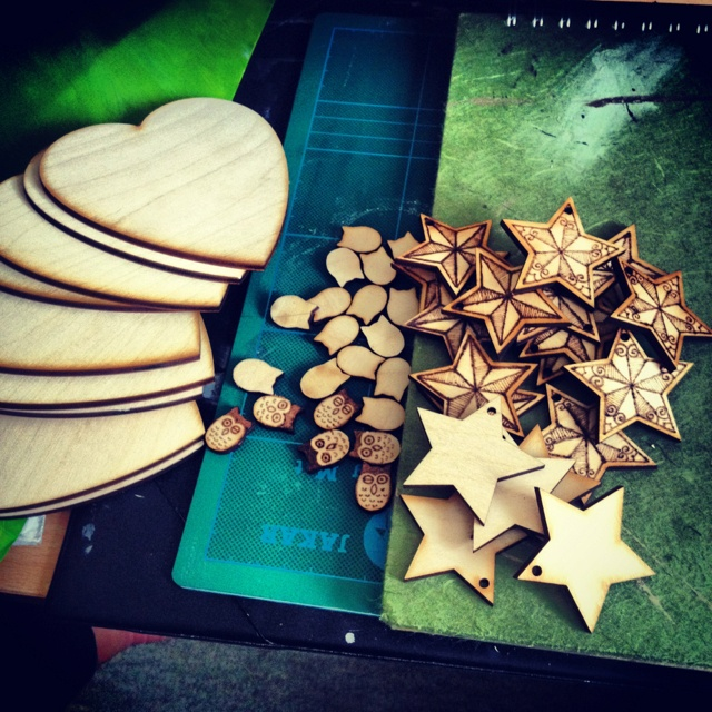 Wooden pyrography stars hearts and owls.