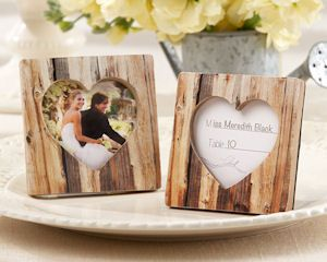 Rustic Romance Wood Heart Place Card Holder & Photo Frame (Kate Aspen 25111NA) | Buy at Wedding Favors Unlimited (http://www.weddingfavorsunlimited.com/rustic_romance_wood_heart_place_card_holder_and_photo_frame.html).