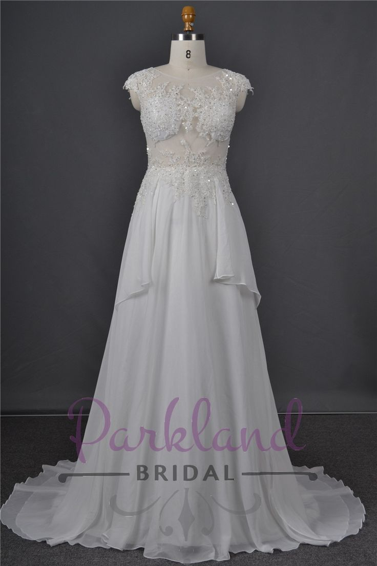 http://www.parklandbridal.co.nz/Store/tabid/4393/ProdID/33794/CatID/358/Parkland_Bridal_Farrah.aspx  A stunning lace gown with a sheer bodice, covered with appropriately placed lace, cups and beading. Has two chiffon drops down the side.