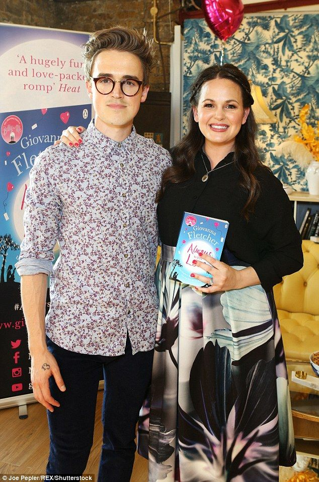 Loved up: The McFly frontman proudly support his wife of four years Giovanna, who was celebrating the release of her latest book