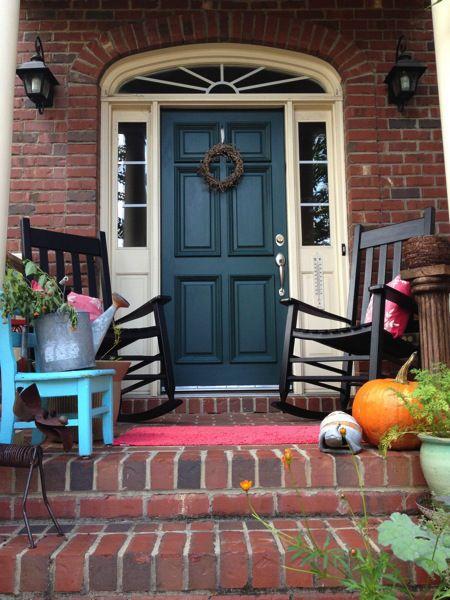 Dark green cream trim and red brick  Front Door With