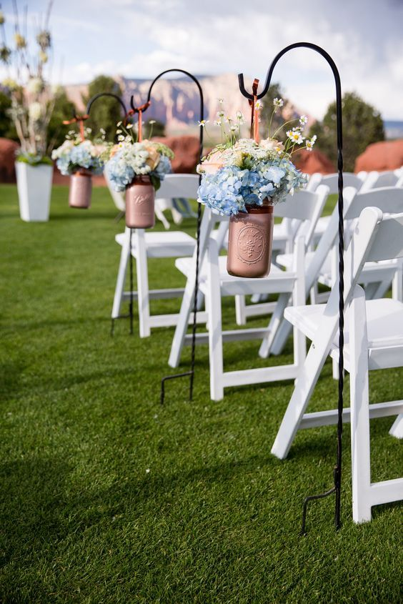 Copper painted mason jars with blue hydrangea / http://www.himisspuff.com/beautiful-hydrangeas-wedding-ideas/4/