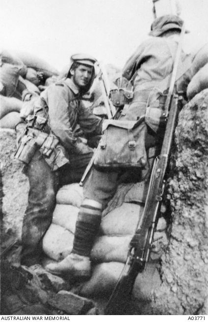 Australian digger uses a periscope in a trench captured during the attack on Lone Pine