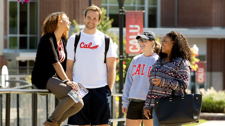 Peer mentors at California University of Pennsylvania meet on campus to talk before walking to class.