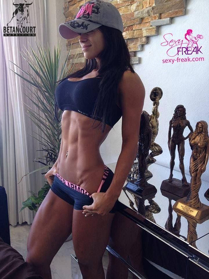 Extreme muscles on abs, but dang, check the trophies! Go ahead GIRL!