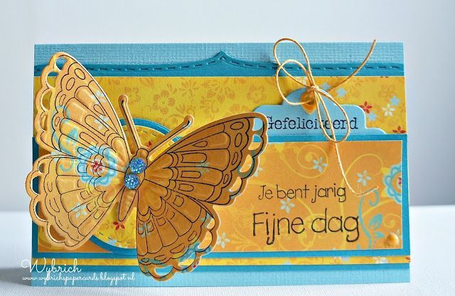 Handmade card by DT member Wybrich with Collectables Tiny's Butterfly 1 (COL1317), Craftables Basic Round, Basic Passe Partouts Round (CR1360), Stitched Hearts and Accolade (CR1362) and Creatables Label Cotton Lace (LR0412) from Marianne Design