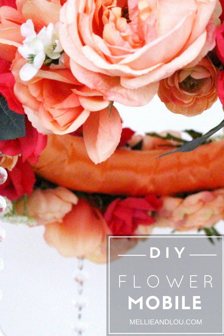 Find out how I made this adorable DIY flower mobile for my baby girls room! It is the perfect finishing touch to any nursery! AND SO CHEAP! It looks like a fancy chandelier and it makes her whole room glitter when the sun shines in just right! swooon!