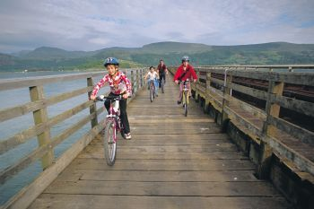 Mawddach Trail - Dolgellau  For those wanting a short ride, this is a great option. Taking you along the old Ruabon to Barmouth railway line from the historic town of Dolgellau to the popular seaside town of Barmouth, you'll be wowed by the stunning views of the Mawddach estuary and Cadair Idris.