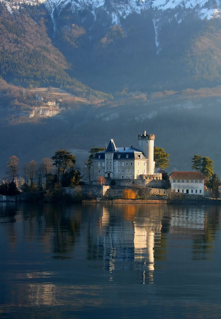 France. The castle at #Duingt reflected in the waters of Lake #Annecy