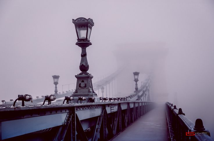Bridge in the fog - The Széchenyi Chain Bridge (Hungarian: Széchenyi lánchíd, Hungarian pronunciation) is a suspension bridge that spans the River Danube between Buda and Pest, the western and eastern sides of Budapest, the capital of Hungary. Designed by the English engineer William Tierney Clark, it was the first permanent bridge across the Danube in Hungary, and was opened in 1849.  If you like this work please me a Like, or write a Comment, or Share, or Follow :)  <a…