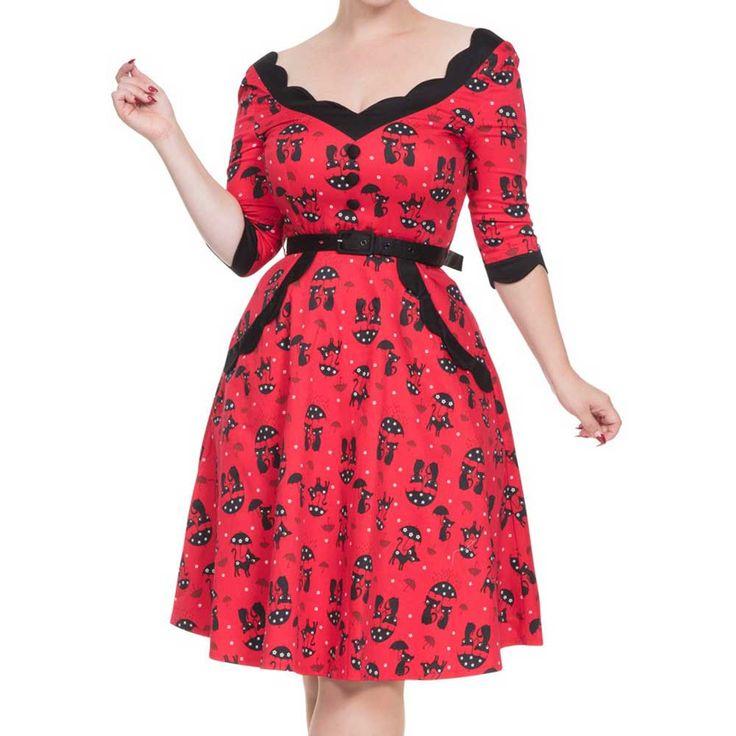 Voodoo Vixen. Er wordt altijd gezegd dat zwarte katten ongeluk brengen, maar deze jurk met retro katten print brengt het tegenovergestelde! De jurk is met mooie golven afgewerkt bij de halslijn, manchetten en zakken, heeft een prachtige pasvorm, een riem en een knoop detail op de voorkant.