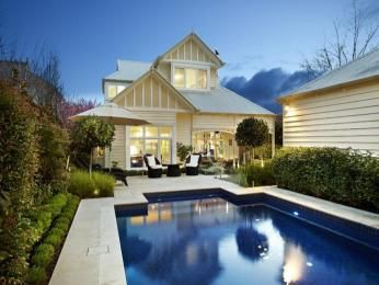 Weatherboard edwardian house exterior with floor-to-ceiling windows & hedging - House Facade photo 527093