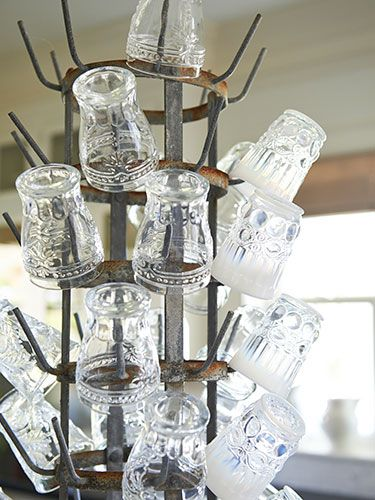 A bottle-drying rack keeps #Anthropologie glasses within easy reach on the kitchen island. #kitchens